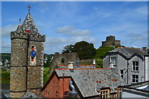 SX3384 : View over rooftops to Launceston Town Hall and Castle by David Martin