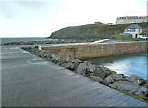NW9954 : The corner of the harbour and cliffs below the radio station by Ann Cook