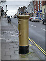SZ3295 : Lymington High Street, Ben Ainslie's Golden Postbox by David Dixon