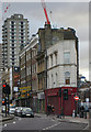TQ3381 : Ghost sign, Commercial Street by Julian Osley