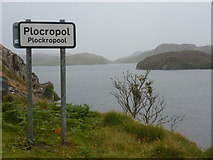 NG1793 : Plocropol: Loch Plocropol and a welcome sign by Chris Downer