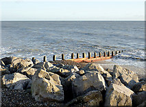 TQ1602 : Boulders and groyne by Worthing, East Sussex by Roger  Kidd