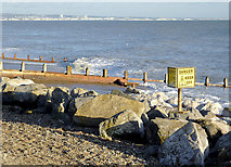 TQ1602 : Boulders and groynes by Worthing, East Sussex by Roger  Kidd