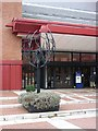 TQ2982 : Sculpture by the doorway of the British Library by Oliver Dixon