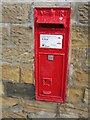 NU1328 : Postbox, Warenford by Richard Webb