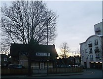 TQ2075 : The sun sets on Charlie Butler Public House, Mortlake by David Anstiss