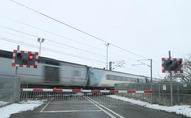 Train passing Stubton Road Level Crossing, Claypole