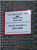 TL1314 : B652 Station Road Railway Bridge sign by Adrian Cable