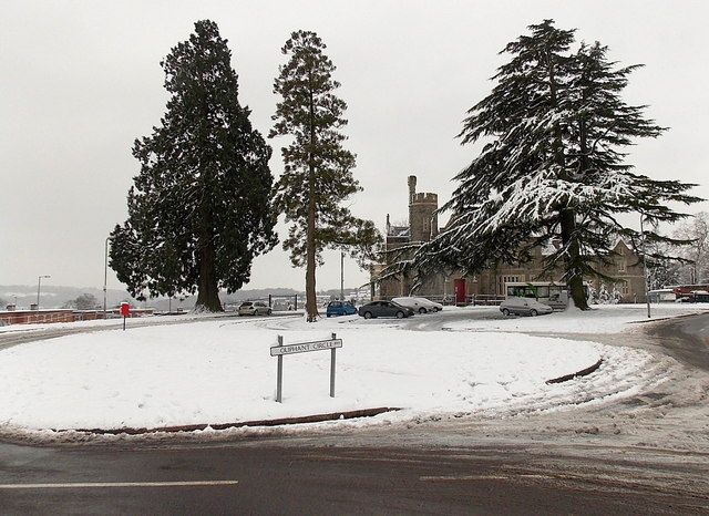 Snowy roundabout, trees and Malpas Court, Oliphant Circle, Newport