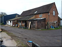 SJ8224 : Barns at Ashwoodhead Farm by Richard Law