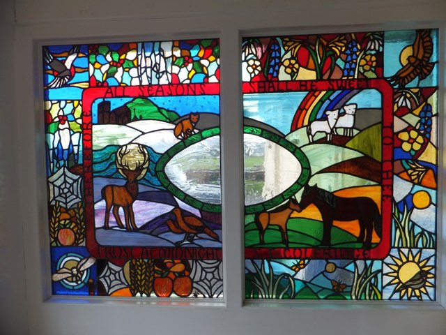 Stained glass window in village hall at Wheddon Cross