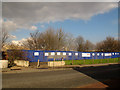 TQ4078 : Blue hoarding on Woolwich Road by Stephen Craven