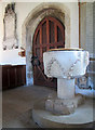 SK8101 : Belton-in-Rutland: St Peter - font and south door by John Sutton