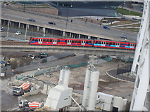 TQ3980 : View of a DLR train from the Emirates Air Line by Robert Lamb