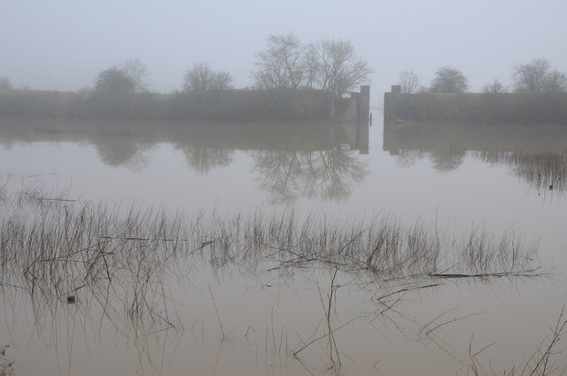 Railway embankment reflected in floodwater