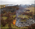 SD6255 : Heather burning near Millers House by Ian Taylor