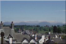SD3598 : Hawkshead: view of the mountains over rooftops by Christopher Hilton