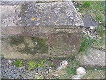 TA0912 : Benchmark on the porch of St John's Church, Croxton by John Slater
