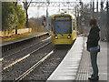 SJ8196 : Metrolink Tram Approaching Trafford Bar by David Dixon