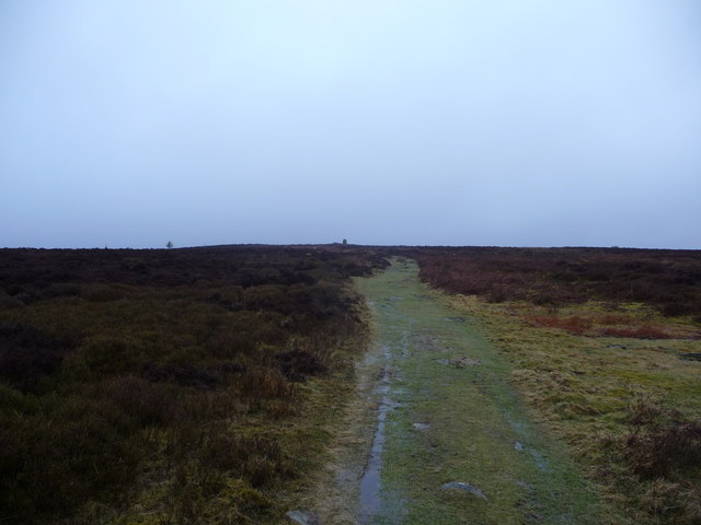 Approaching the tall cairn on Garn Wen in the Black Mountains