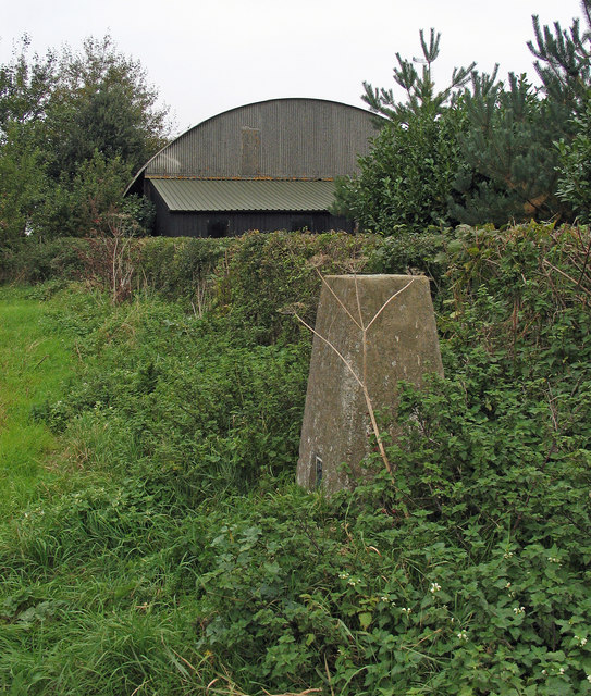 Trig point, hedge and barn