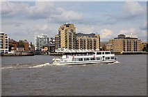 TQ3680 : A riverboat passing Limehouse Basin Entrance by Steve Daniels