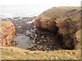 NU0054 : Looking out to sea from above Brotherston's Hole by Graham Robson