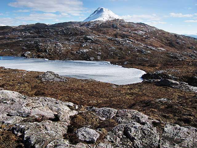 A Frozen Lochan in a Rocky Moorland