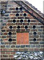 SU9495 : The Bottle Cottages: bottle decoration and terracotta tile by Stefan Czapski