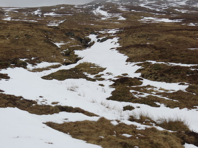 Snow filled burn course on the lower slopes of Beinn a' Chleibh