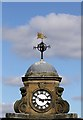 NT5014 : A clock and weather vane at Drumlanrig Square, Hawick by Walter Baxter