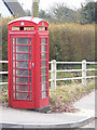 TM2994 : Telephone Box on The Street by Adrian Cable