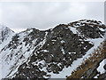 NG9919 : Snow and slabby crags high in Coire Gorm by Richard Law