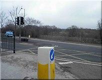 SJ9995 : Traffic bollard at the junction of  A57 and A6018 Mottram in Longdendale by Steve  Fareham