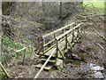 SE6797 : Wooden footbridge over beck by Pauline E