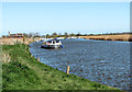 TG4110 : Boat travelling up the River Bure, Acle by Evelyn Simak