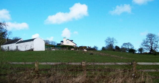 Traditional farm buildings and a bungalow above Sturgan Brae