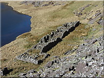 SH6454 : Ruined miners' buildings beside Llyn Teyrn by Gareth James