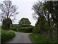 TM3687 : Manor Farm Lane & the entrance to Manor Farm by Adrian Cable