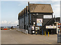 TR1066 : Huts at Whitstable Harbour by David Dixon