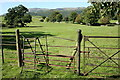 SD2188 : Stile and footpath through West Park by Rob Noble