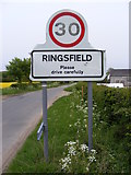 TM4087 : Ringsfield Village Name sign on School Road by Adrian Cable