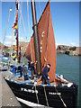 NT6779 : Coastal East Lothian : Three Men In A Boat by Richard West