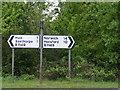 TG1129 : Roadsigns on the B1149 Holt Road by Adrian Cable