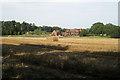 SP1167 : Harvested wheatfield near Heath Farm by Robin Stott