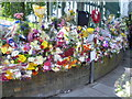 TQ4378 : Floral tributes on the corner of Artillery Place and John Wilson Street by Marathon