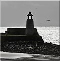 NX0940 : The old lighthouse at Port Logan Harbour by Walter Baxter