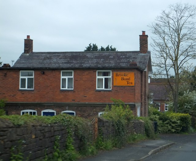 Brick-built cottage in Eardiston with an old advertisement