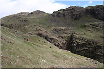 NY2201 : Crags above Hardknott Pass by Anne Burgess