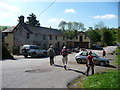 SO3996 : Walkers pass by the pub at Bridges, Shropshire by Jeremy Bolwell